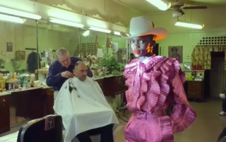 hair salon, mirrors, pink glitter outfit, red lipstick, cowboy hat