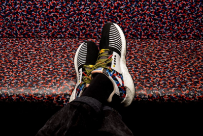 colorful seat pattern, train, white sneaker with details, black and white striped