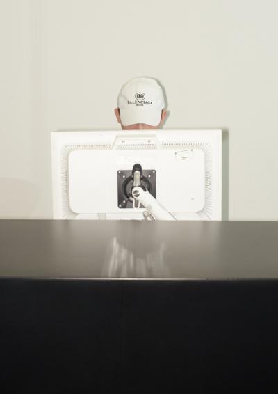 white cap, reception desk, white colored computer, black desk