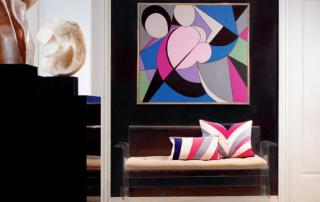 colorful painting, striped cushion, statue, living room