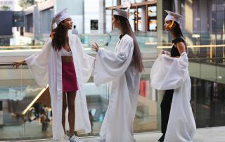 pink skirt, mini skirt, white top, white robe, graduation hat, white sneaker
